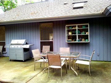 Back patio fully equipped with grill. Bike path is right through the trees.