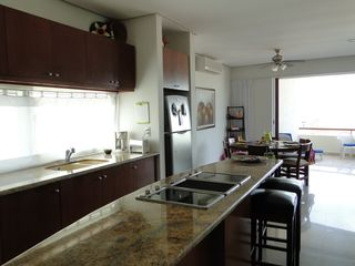 Isla Mujeres condo photo - Complete kitchen with stove and cooktop