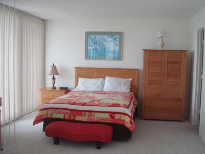Master Bdrm with private bath has TV and also overlooks the ocean.