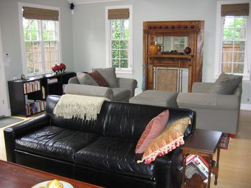 The spacious 500-sq.-ft. great room is light and airy and has two seating areas.