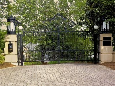 Private gated entryway to a truly magical estate.
