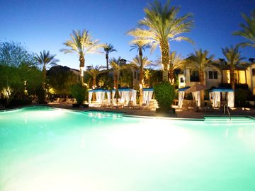 La Quinta condo rental - Main Walk-In Beach Pool at Sunset with Cabanas and Amazing Mountain Views