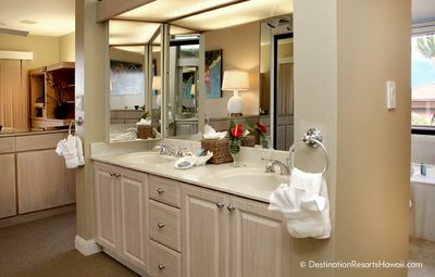 The up-to-date master bath has two sinks