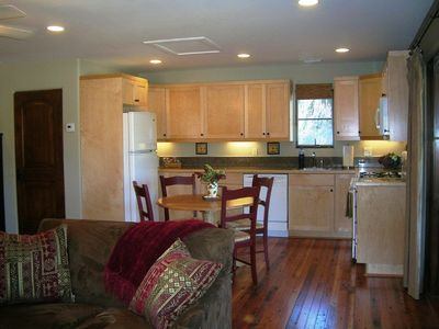 The fully equipped kitchen with custom cabinets & granite counter tops
