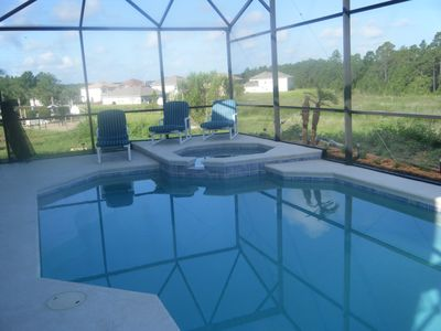 Pool and spa, with plenty of lounge chairs and pool toys
