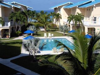 Grand Cayman condo photo - Pool with umbrellas and loungers
