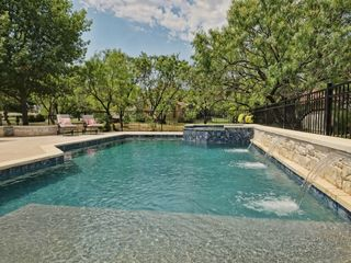 Horseshoe Bay house photo - Amazing new pool and hot tub!! Covered patio, Large firepit and outdoor seating