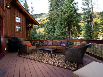 Large deck with tons of seating and BBQ Grill