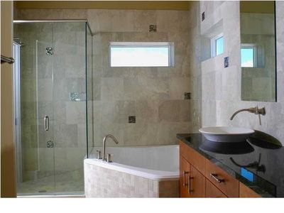 master bath with jetted tub, double vanity, walk in closet