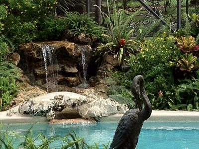 Waterfall flows into pool in 3,000 sf, very private, tropical entertainment area