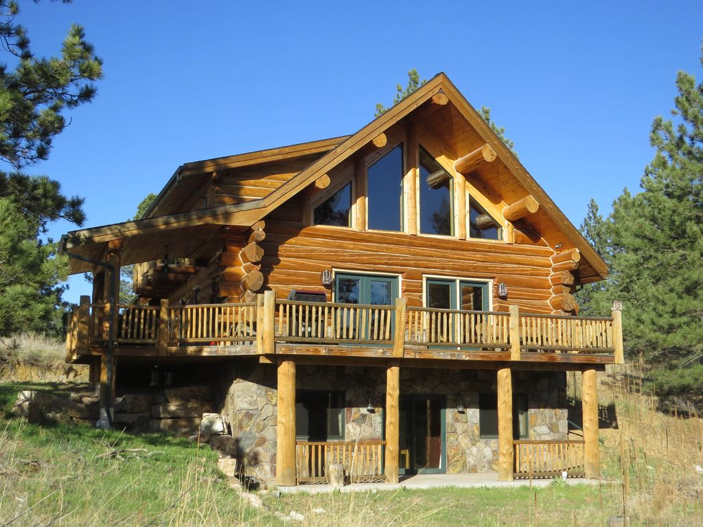 Nearly new hand hewn log home on 11 secluded vrbo for Hewn log cabin kits
