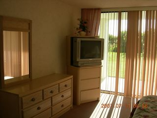 Master Suite TV and View of Dune and Ocean - Cocoa Beach condo vacation rental photo