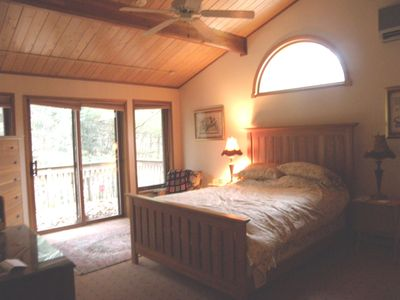 Master Bedroom, sliding doors leading to hot tub, overlooking creek.