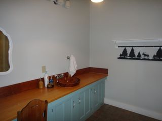 Custom wooden counter in large bath. - Ludlow house vacation rental photo