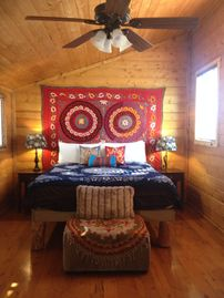 Wrightwood cabin rental - Large master bedroom with king bed, sofa, balcony, desk, ceiling fan, heater.