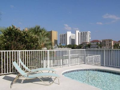 Private, lakefront pool with large patio and multiple balconies.