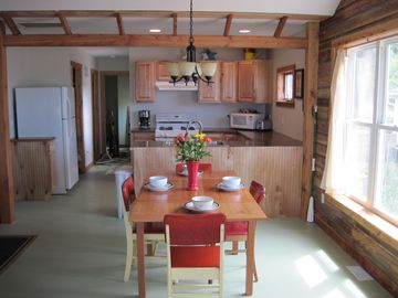 Dining room and fully equipped kitchen includes 8-cup coffee maker.