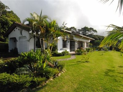 Nuevo Arenal house rental - Front view of home, with surrounding rainforest and lake view!