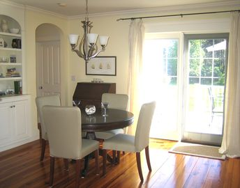 Dining room opens to spacious deck. Designer Pella windows/doors throughout.