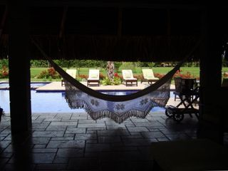 Relax at the hammocks next to swimming pool