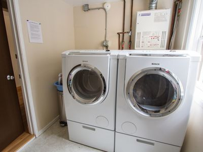 Laundry room with XL Bosch washer and dryer