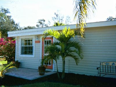 Open the front door to this Key West style cottage to discover treasures within.