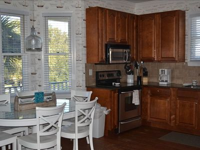 Open floor plan with fully-stocked kitchen and breakfast nook that seats 6.