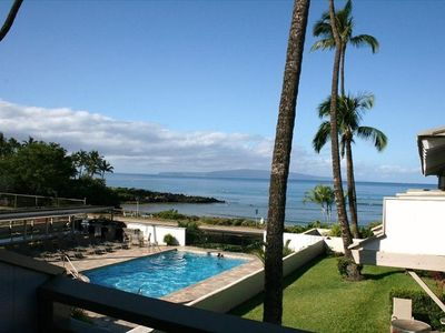 View from lanai overlooking solar-heated Pool/Spa, BBQ/Picnic Area, Tennis Court
