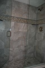 Redington Shores condo photo - The walk in master shower is a luxury in itself.