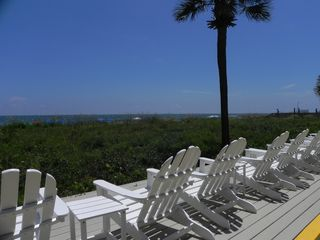 Palmetto Dunes condo photo - Deck chairs overlook the dunes and the ocean. They are far from the pools.