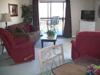 Branson condo photo - Living Rm from Dining Area - walkout on deck - beautiful view of the 10 Fairway
