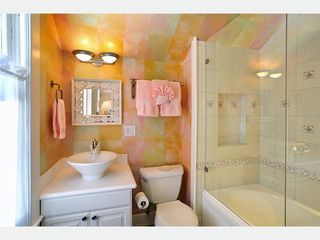Key West house photo - The Southernmost Bathroom 2 is en-suite, has tub & shower with frameless gla