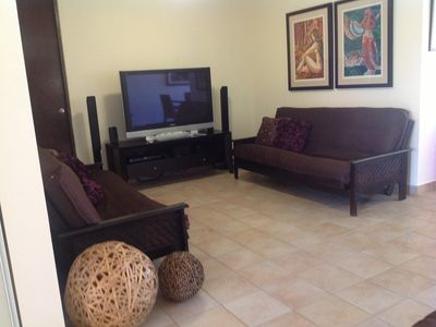Family Area with Home Theater, Flat Screen TV and two full size Futon's...
