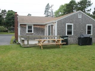 Bourne cottage photo - Bench seating on deck along with picnic table for outdoor eating...