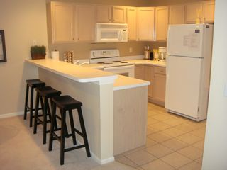 Osage Beach condo photo - Full kitchen with breakfast bar....