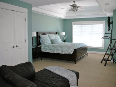 South Haven house rental - Master bedroom with TV, love seat, and doors leading out to the patio