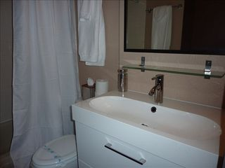 Stateline condo photo - 1st floor bathroom with shower, tub, toilet, and vanity with storage