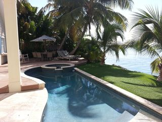 Summerland Key house photo - Backyard is shaded with lots of teak furniture