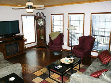 Family Room with 50 inch TV, Grandfather Clock, Fireplace, Ample Seating.