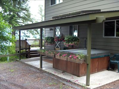 Exterior and Hot Tub under porch with sky lights