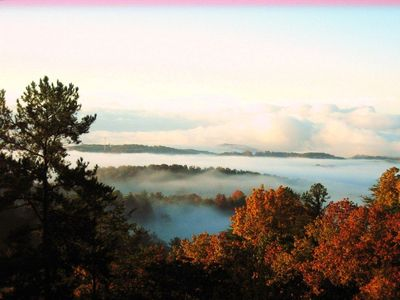 Early morning fall view with the mist revealing the trees and mountain ranges