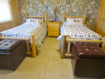 Bedroom #3 and #4 each contain two twin beds, dresser, closet, and storage cubes