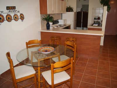 Dining room table seats 4.  2 stools at kitchen counter.