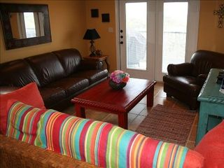 New Braunfels condo photo - Colorful living area with french doors out to the balcony.