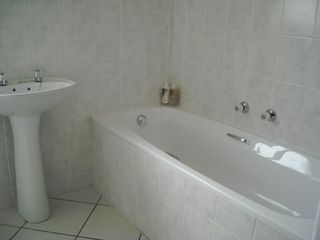Milnerton condo photo - bath and sink all tiled bathroom with seperate shower