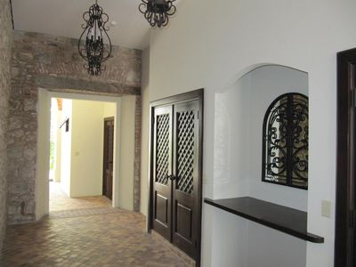 Entrance of the condominium with the charming Calicanto walls