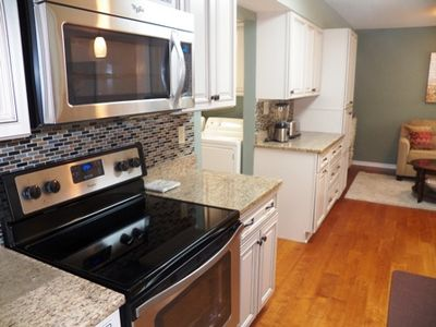 Kitchen with custom cabinets and stainlees steel range and microwave