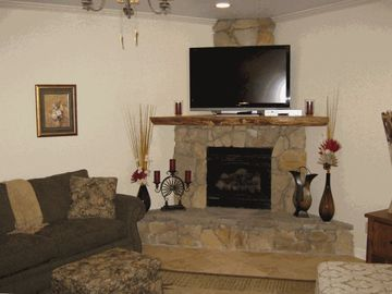 Banner Elk townhome rental - Living area has custom stone fireplace, 52' HDTV premium package and WiFi