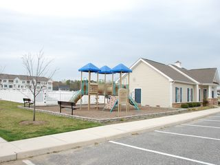 Rehoboth Beach house photo - Clubhouse with playground, tennis court and swimming pool