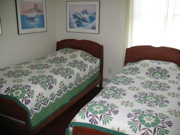 One of two rooms with twin beds